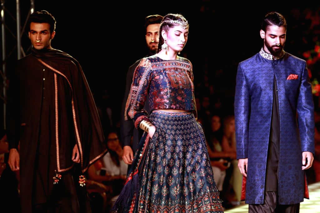 Models walk the ramp displaying an outfit by fashion designer Anita Dongre during the India Couture Week 2016, in New Delhi on July 21, 2016.