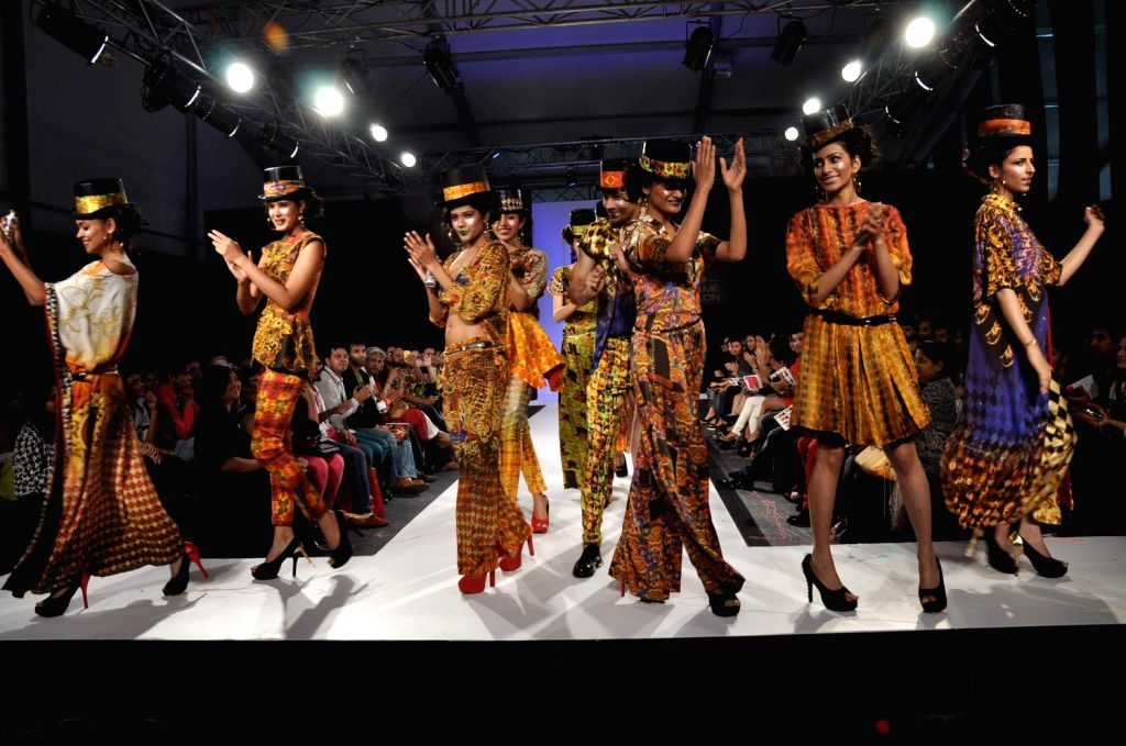 Models walk the ramp displaying an outfit by Indian designer Ken Ferns during the Lakme Fashion Week Summer/Resort 2013 Day 2, in Mumbai on March 23, 2013.