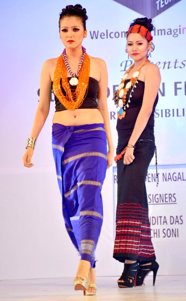 Models walk the ramp during 9th JD Design Fest 2014 at ITA Machkhowa centre in Guwahati  on July 27, 2014.