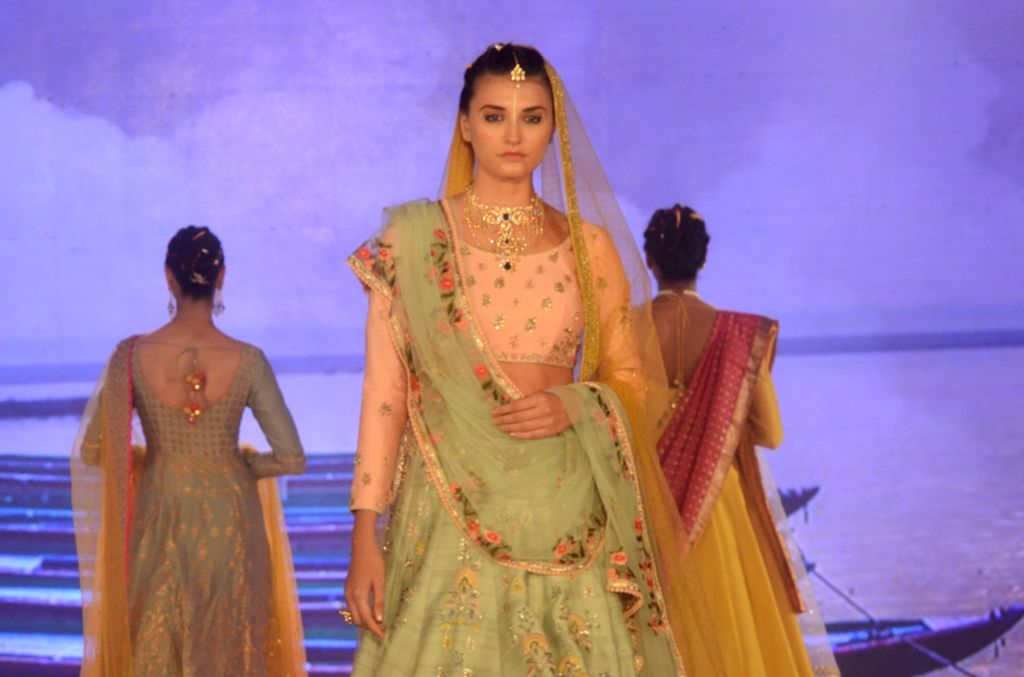 Models walk the ramp during a fashion show organised to mark International Women's Day on March 7, 2017.