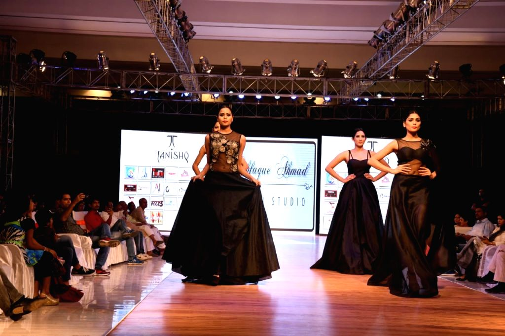 Models walk the ramp during a fashion show organised in Patna on Aug 10, 2018.