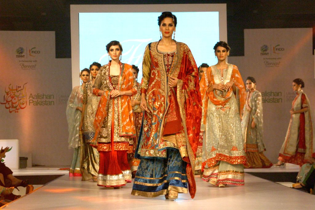 Models walk the ramp during a fashion show ahead of Aalishan Pakistan - a four-day-long lifestyle exposition organised by the Federation of Indian Chambers of Commerce and Industry (FICCI) and Trade .