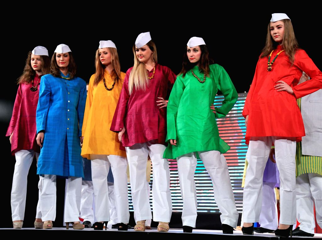 Models walk the ramp during a fashion show at Birla Auditorium in Jaipur on June 29, 2014.