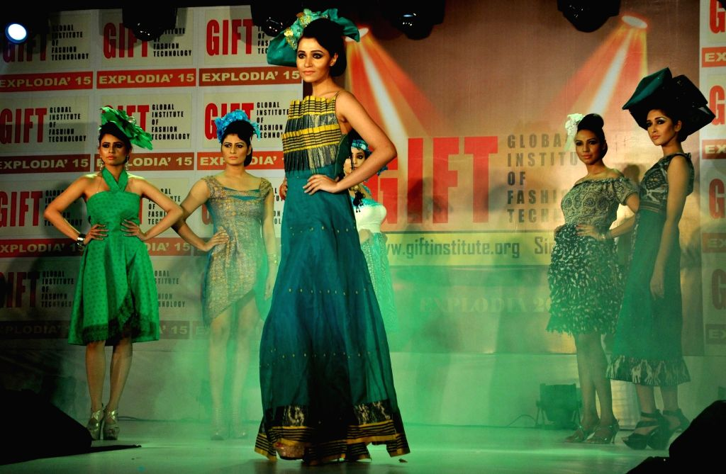Models walk the ramp during a fashion show in Kolkata, on Dec 11, 2015.