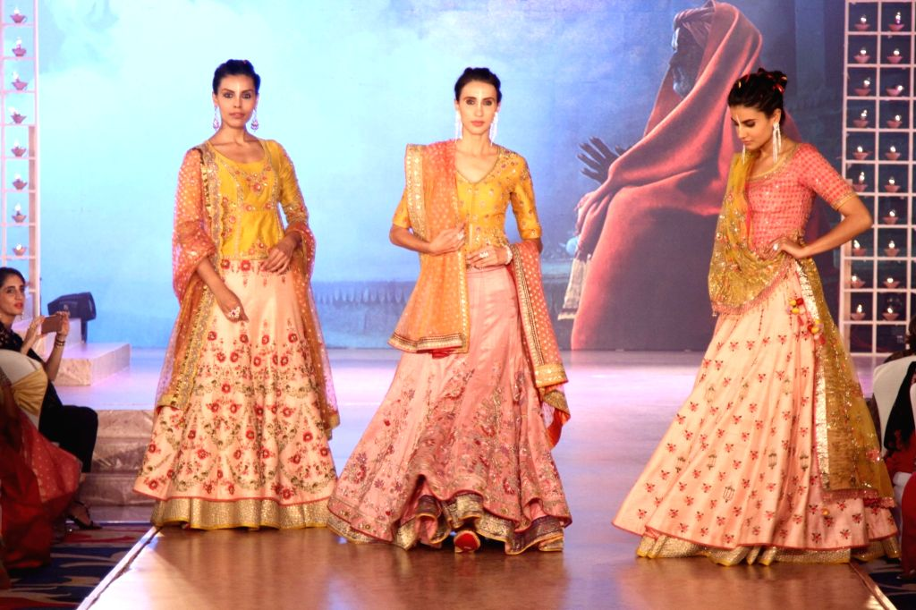 Models walk the ramp during Archana Astitwa Awards 2017 in Mumbai on March 7, 2017.