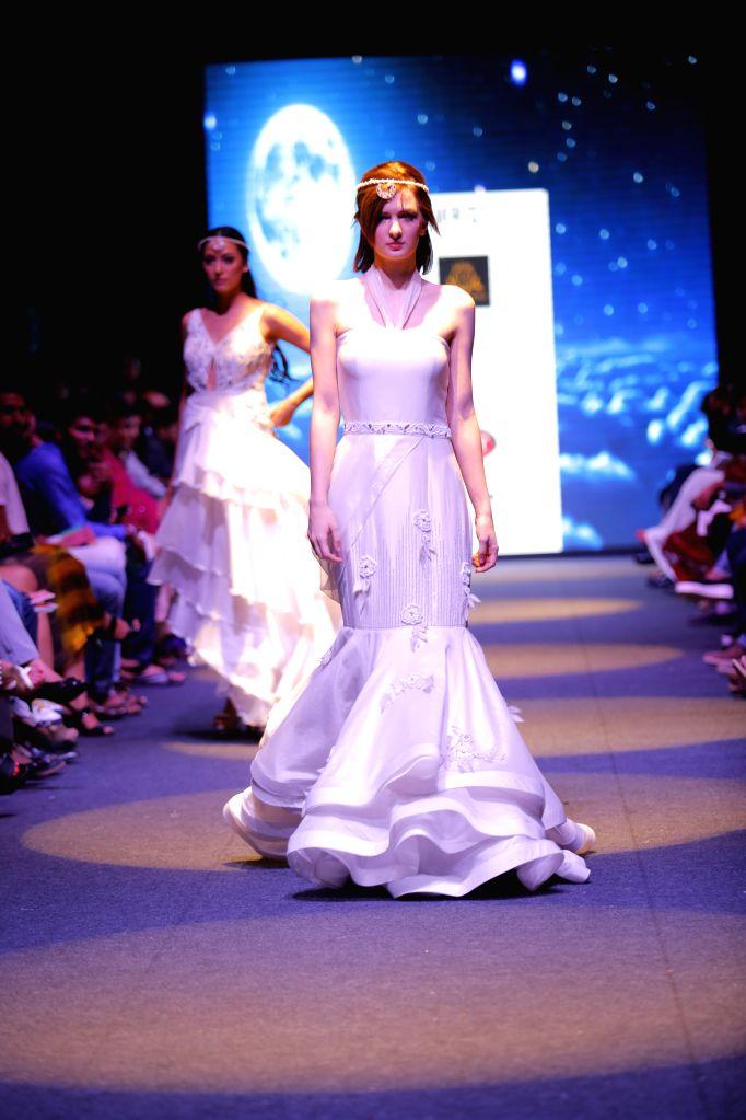 Models walk the ramp during launch of Designer Mithi Kalra\'s new \'Moonlight Collection\' at the India Runway Week.