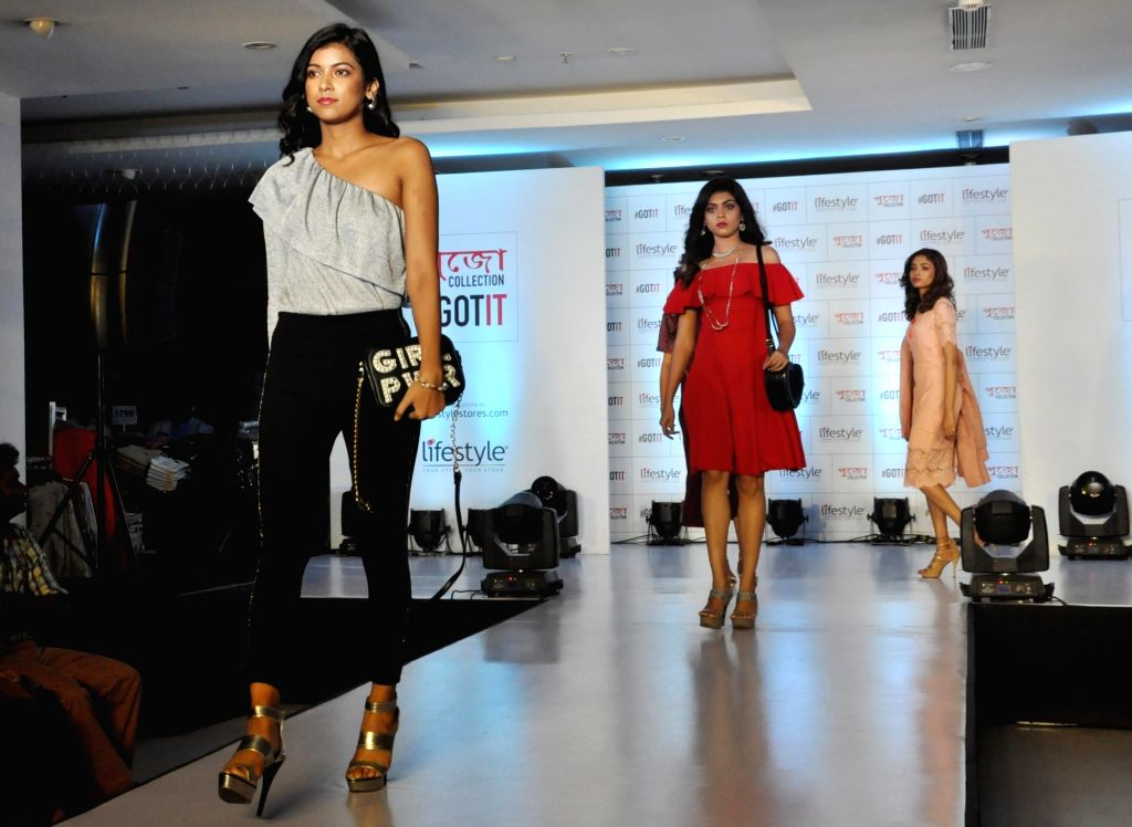 Models walk the ramp during launch of the festive collection of a fashion brand ahead of Durga Puja, in Kolkata on Sept 11, 2018.