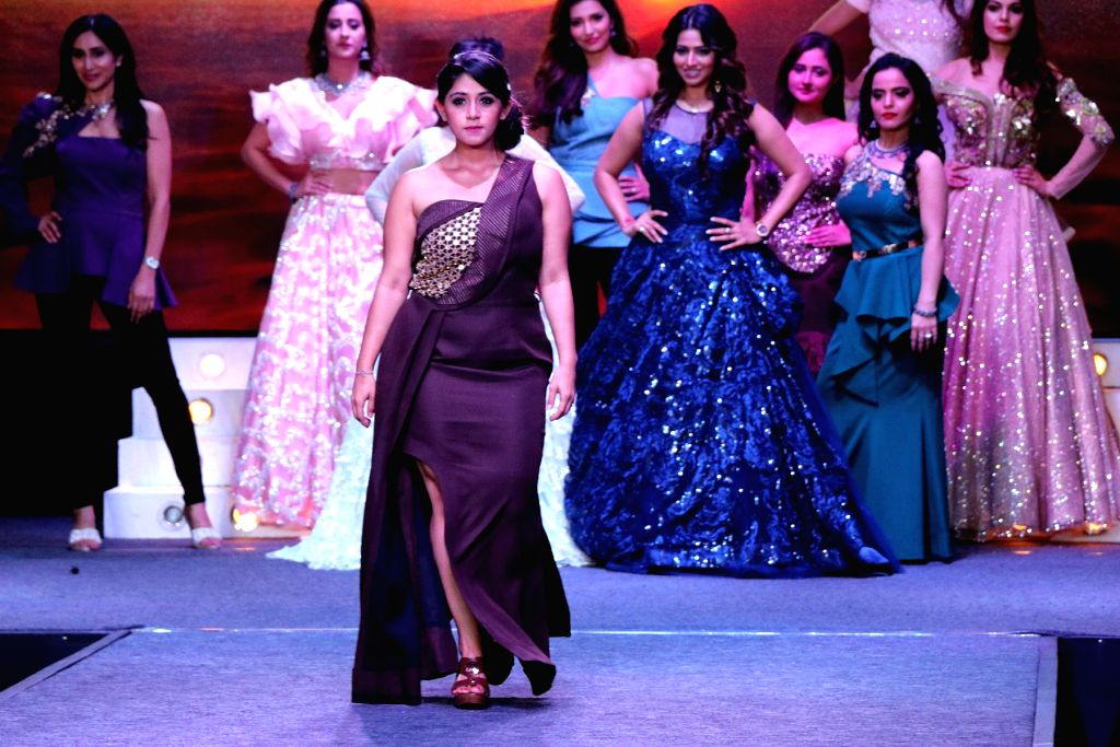 Models walk the ramp during the launch of a design studio, in Bengaluru on May 26, 2018.