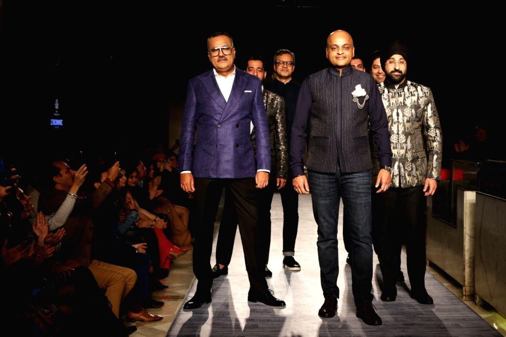 """Models walk the ramp during """"The Men's Fashion show"""" in New Delhi on Feb 16, 2019."""
