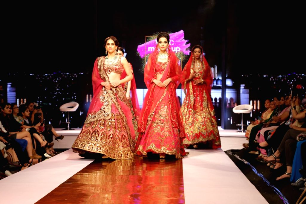 Models walk the ramp during the VLCC's Bridal Looks 2017 in New Delhi on Aug 12, 2017.