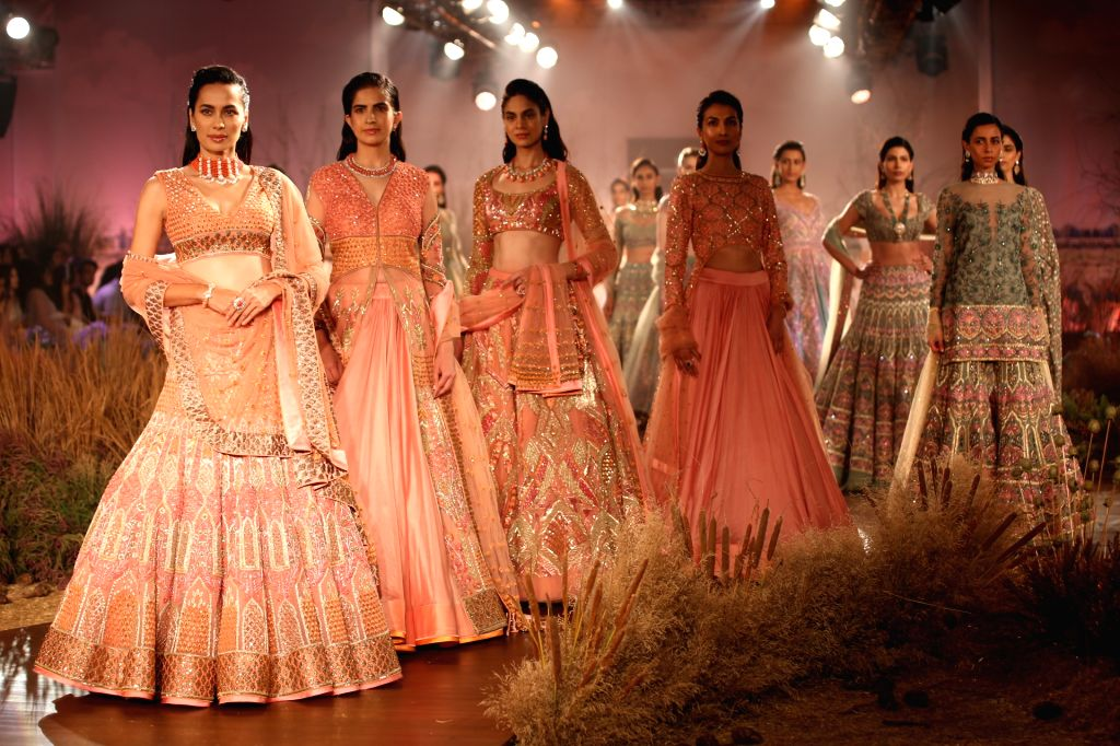 Models walk the ramp for designer Reynu Tandon at India Couture Week 2019 in New Delhi, on July 26, 2019.