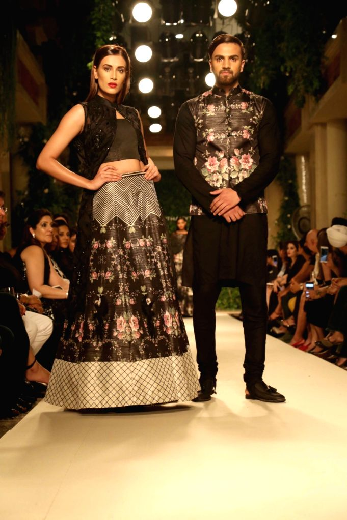 Models walk the ramp for designer Siddhartha Tytler Couture Show in New Delhi on Sept 2, 2017.