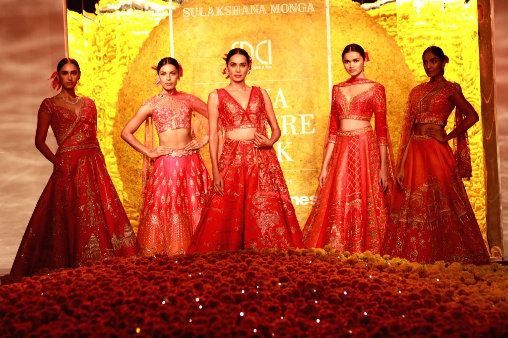 Models walk the ramp for designer Sulakshana Monga at India Couture Week 2019 in New Delhi, on July 25, 2019.