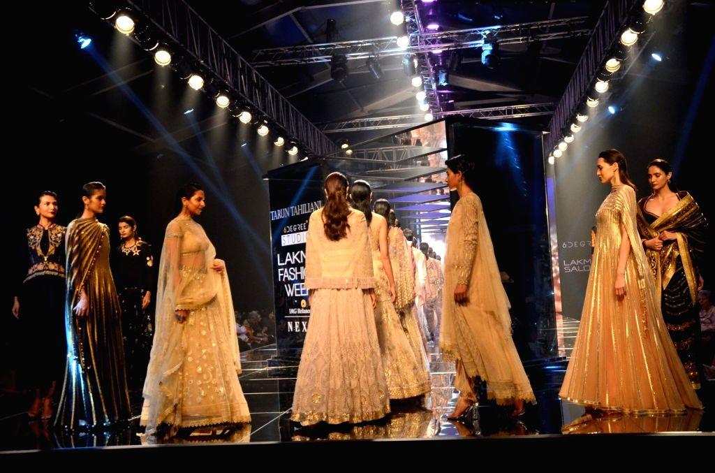 Models walk the ramp for fashion designer Tarun Tahiliani during the Lakme Fashion Week Summer/Resort 2018 in Mumbai on Feb 2, 2018.