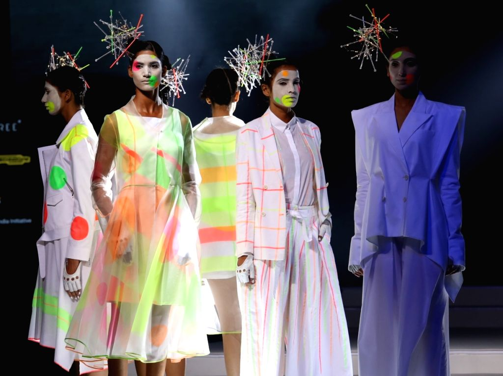 Models walk the ramp Grand finale of India Fashion Week, in New Delhi on Oct 12, 2019.