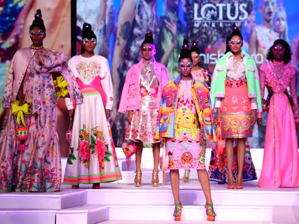 Models walk the ramp Grand finale of Make-up India Fashion Week, in New Delhi on Oct 12, 2019.
