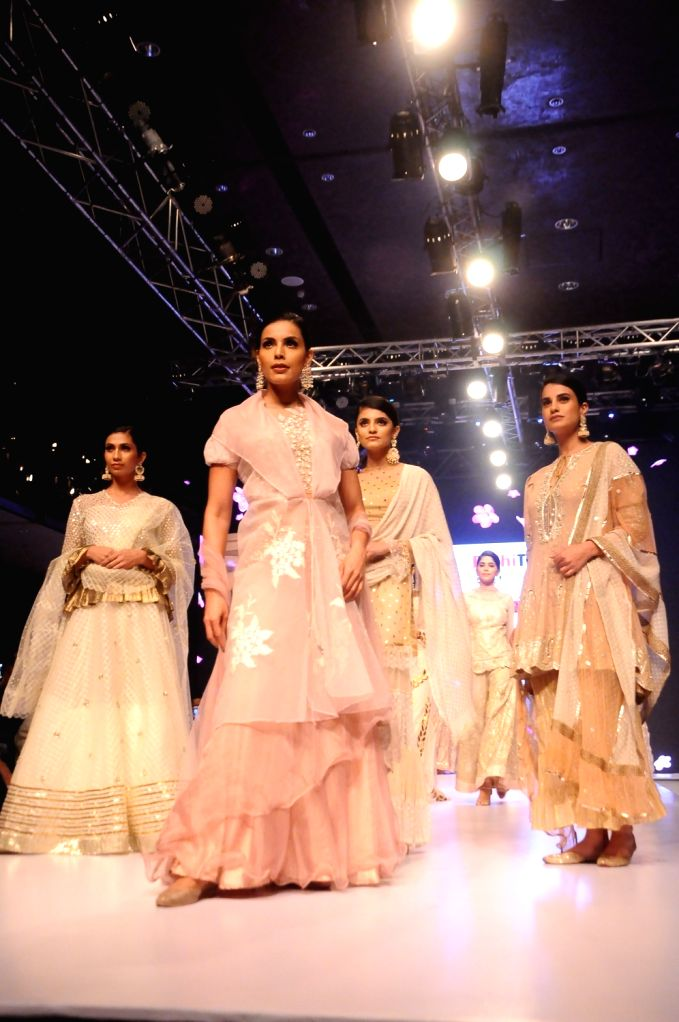 Models walk the ramp on Day 1 of the Delhi Times Fashion Week, on Sep 21, 2019.