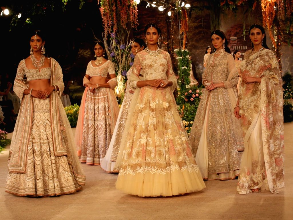 Models walk the ramp showcasing creations of Fashion designer Reynu Taandon at India Couture Week 2018 in New Delhi, on July 29, 2018.