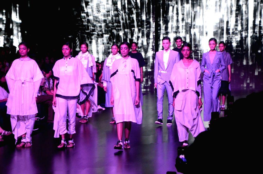 Models walk the ramp showcasing fashion designer Sayantan Sarkar's creation on Day 3 of the Lakme Fashion Week Summer/Resort 2019 in Mumbai, on Feb 1, 2019.