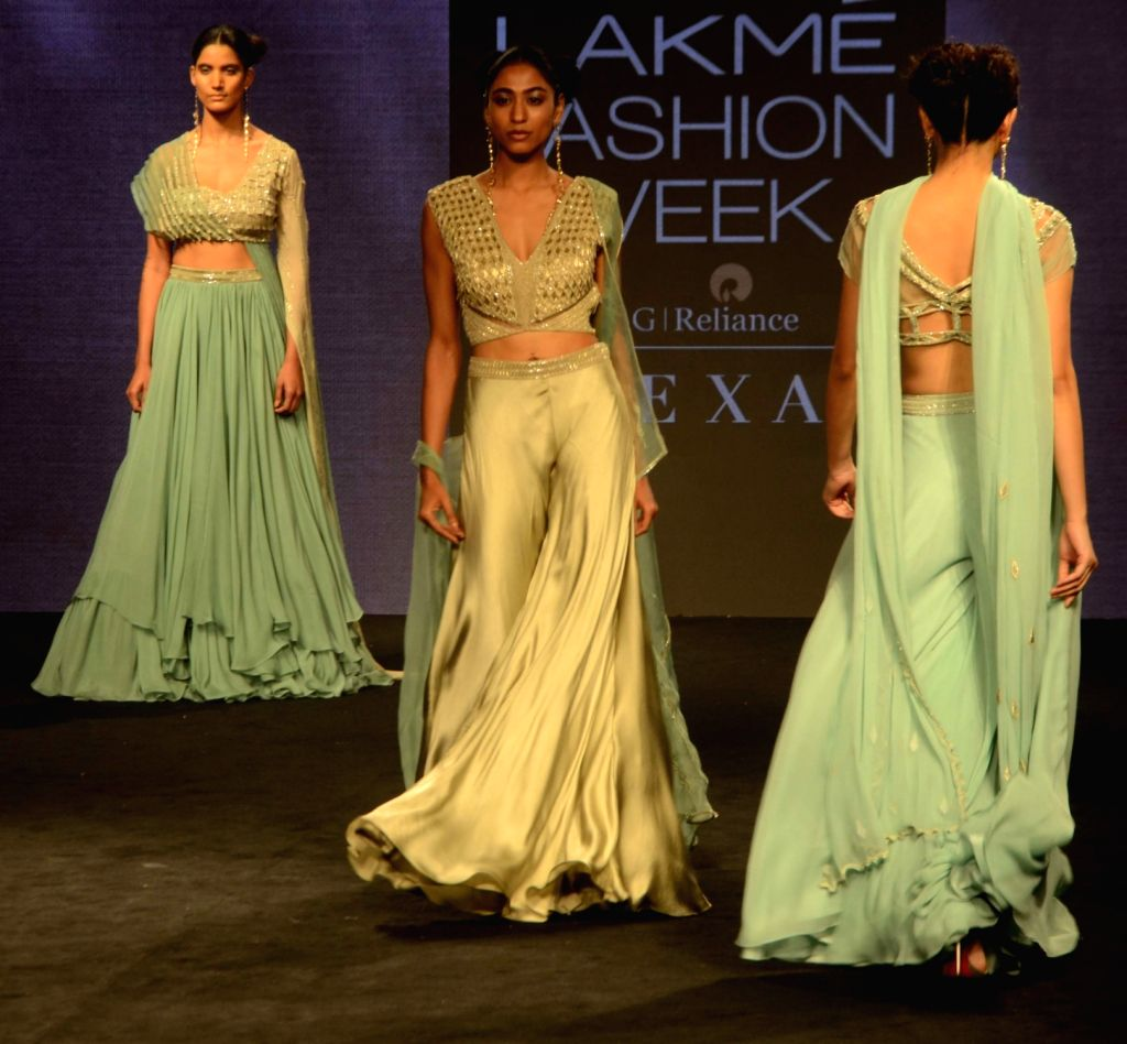 Models walk the ramp showcasing fashion designer Anjali Verma's creation during Lakme Fashion Week (LFW) Summer/Resort 2019 in Mumbai on Feb. 2, 2019.