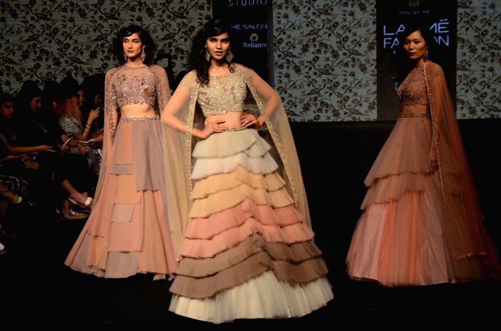 Models walk the ramp showcasing fashion designer Manoj Agarwal's creation during Lakme Fashion Week (LFW) Summer/Resort 2019 in Mumbai on Feb. 2, 2019.