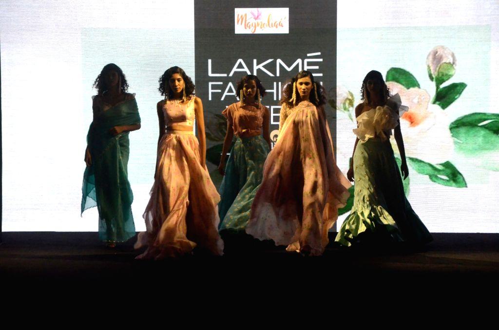 Models walk the ramp showcasing fashion designer Vaani Raghupathy's creation during Lakme Fashion Week (LFW) Summer/Resort 2019 in Mumbai on Feb. 2, 2019.