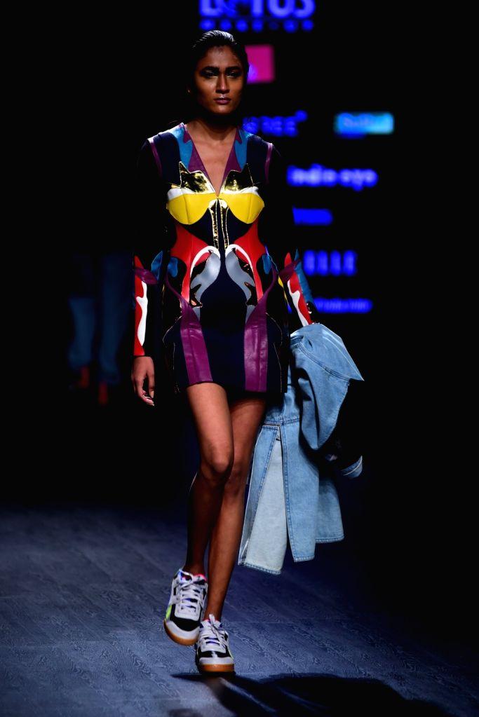 Models walk the ramp showcasing fashion designer Prashant Verma's creation on the second day of Lotus India Fashion Week in New Delhi, on March 14, 2019. - Prashant Verma