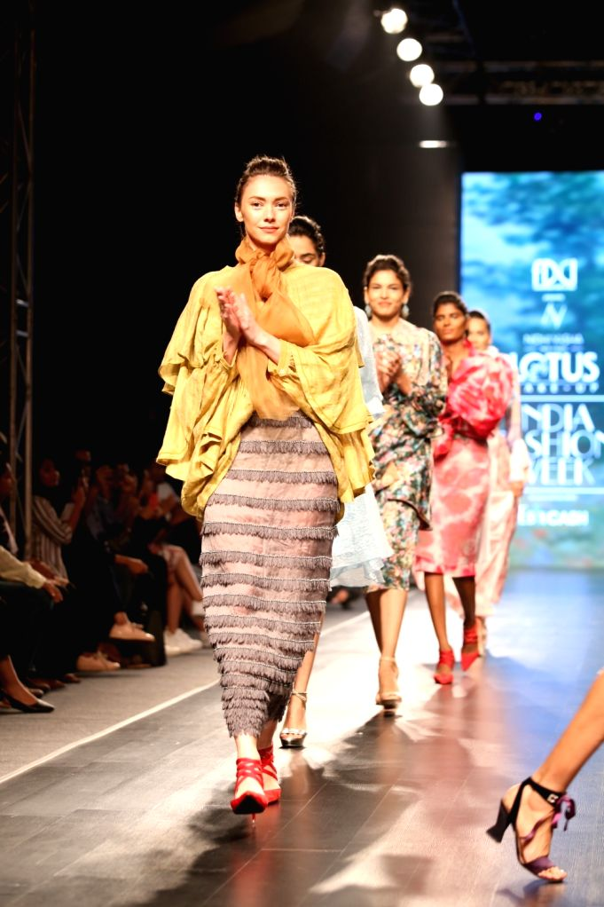 Models walk the ramp showcasing fashion designer Nidhi Yasha's creations on the first day of Lotus Make-up India Fashion Week, in New Delhi on Oct 9, 2019.