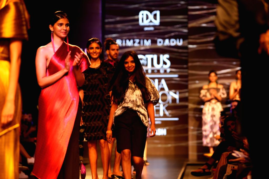 Models walk the ramp showcasing fashion designer Rimzim Dadu's creations on the first day of Lotus Make-up India Fashion Week, in New Delhi on Oct 9, 2019.
