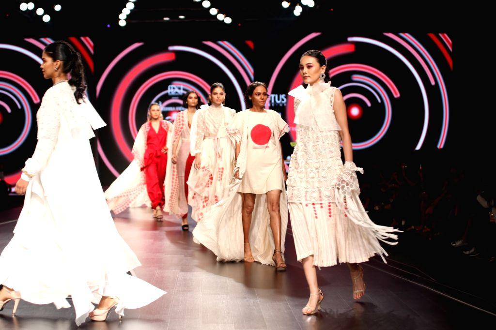 Models walk the ramp showcasing fashion designer Nidhika Shekhar's creations on the third day of Lotus Make-up India Fashion Week, in New Delhi on Oct 11, 2019.