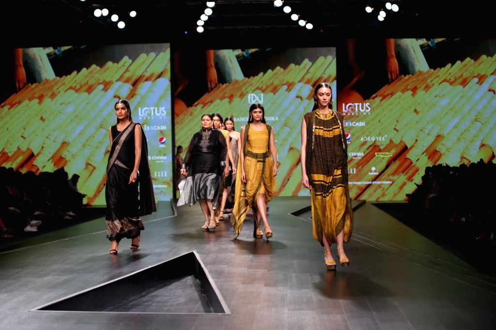 Models walk the ramp showcasing fashion designer designers Rahul Anand and Anushka Laul on the third day of Lotus Make-up India Fashion Week, in New Delhi on Oct 11, 2019.