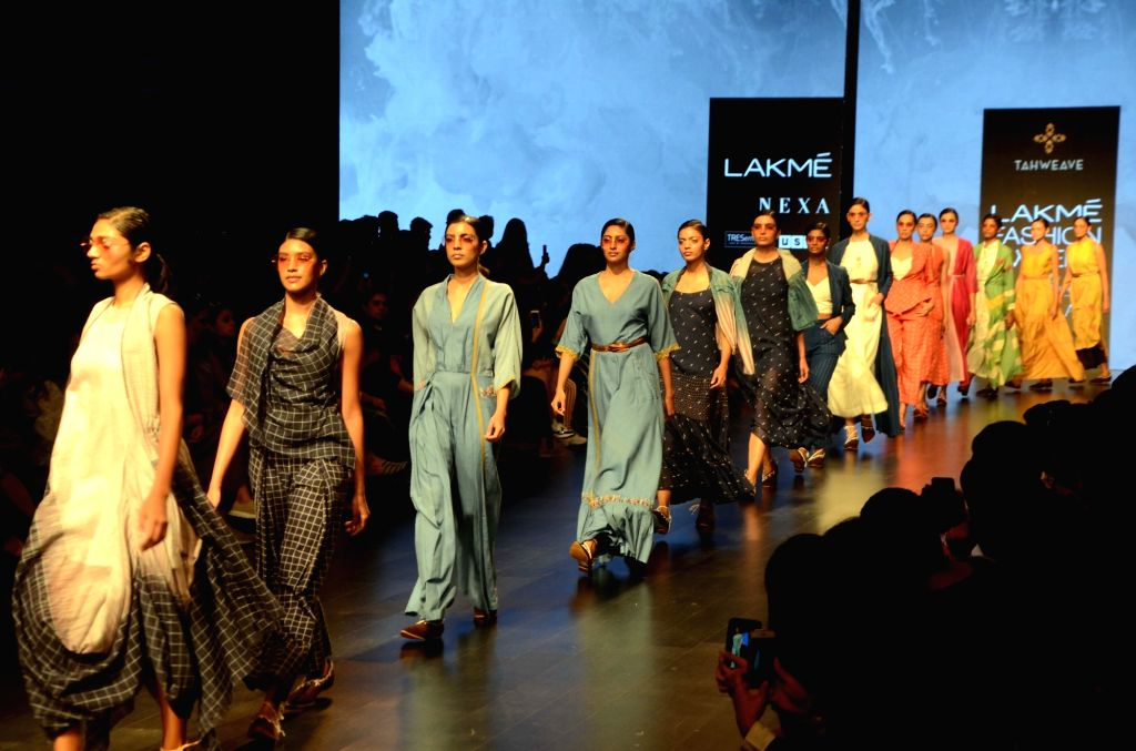 Models walk the ramp showcasing Tahweave's creation on Day 3 of the Lakme Fashion Week Summer/Resort 2019 in Mumbai, on Feb 1, 2019.