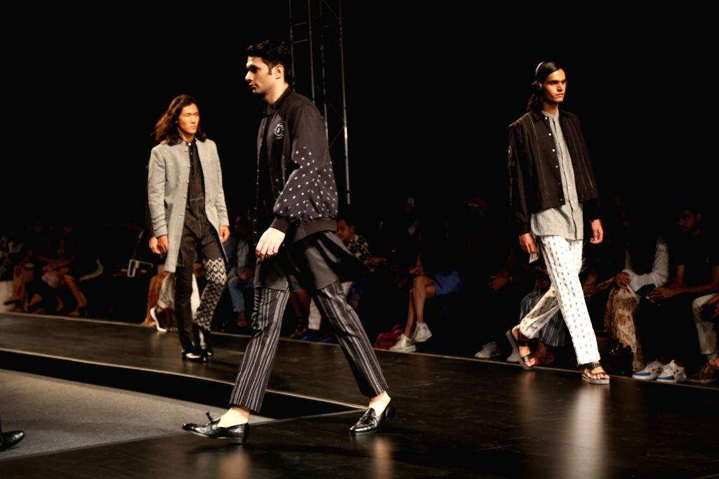 Models walk the ramp showcasing the collection of menswear label Bareek on the fourth day of Lotus Make-up India Fashion Week, in New Delhi on Oct 12, 2019.