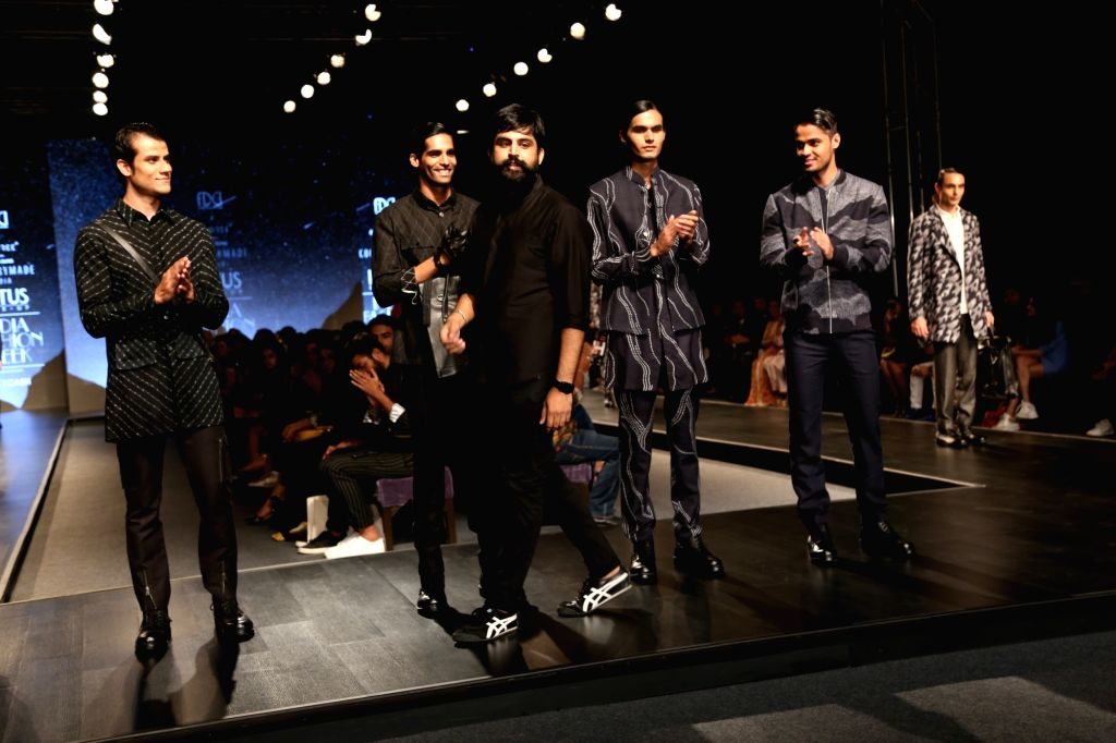 Models walk the ramp showcasing the collection of fashion label Countrymade on the fourth day of Lotus Make-up India Fashion Week, in New Delhi on Oct 12, 2019.