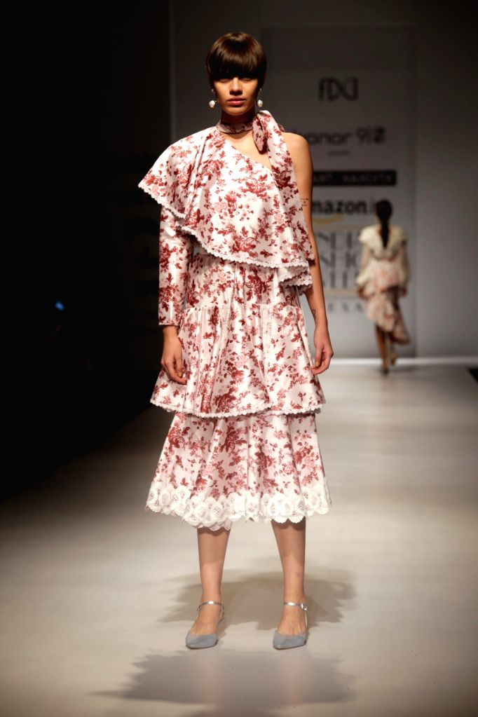 Models walk the ramp showcasing the creations of fashion designer Hemant and Nandita at Amazon India Fashion Week Summer Spring in New Delhi, on October 12, 2017.