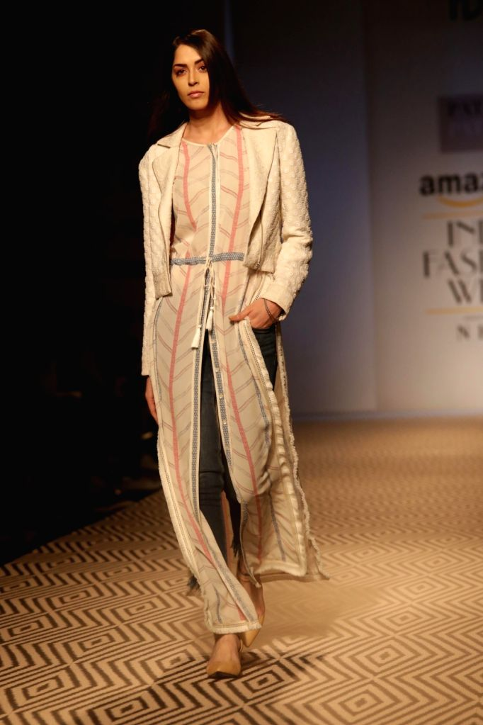 Models walk the ramp showcasing the creations of fashion designer PATINE at Amazon India Fashion Week Summer Spring, in New Delhi, on October 12,2017.