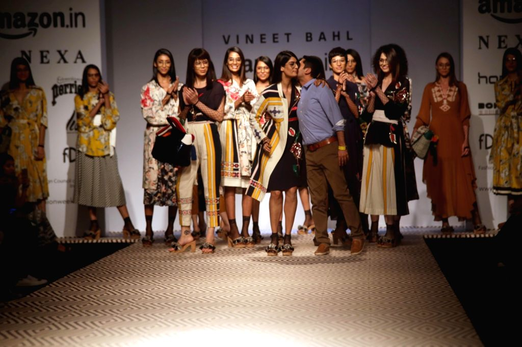 Models walk the ramp showcasing the creations of fashion designer Vineet Bahl at Amazon India Fashion Week Summer Spring in New Delhi on October 12, 2017.
