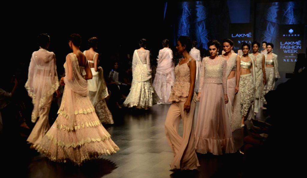 Models walk the ramp showcasing the creations of fashion designer Swapna Anumolu's label Mishru during the Lakme Fashion Week (LFW) Summer/Resort 2019 in Mumbai on Feb 3, 2019.