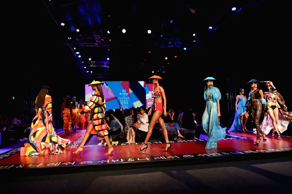Models walk the ramp showcasing the creations of fashion designers Shivan and Narresh  on the fourth day of Lotus Make-up India Fashion Week, in New Delhi on Oct 12, 2019.