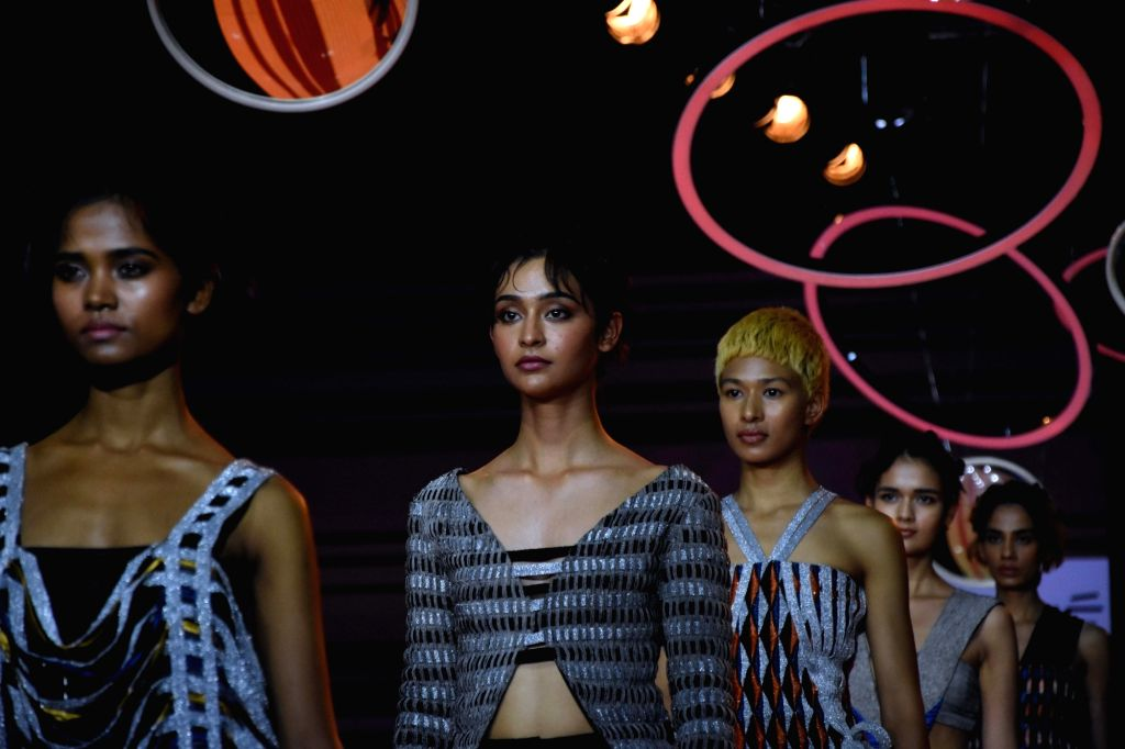 Models walk the ramp showcasing the creations of students of Inter National Institute of Fashion Design West Delhi (INIFD) on Day 2 of the Lakme Fashion Week Summer/Resort 2020, in Mumbai on ...