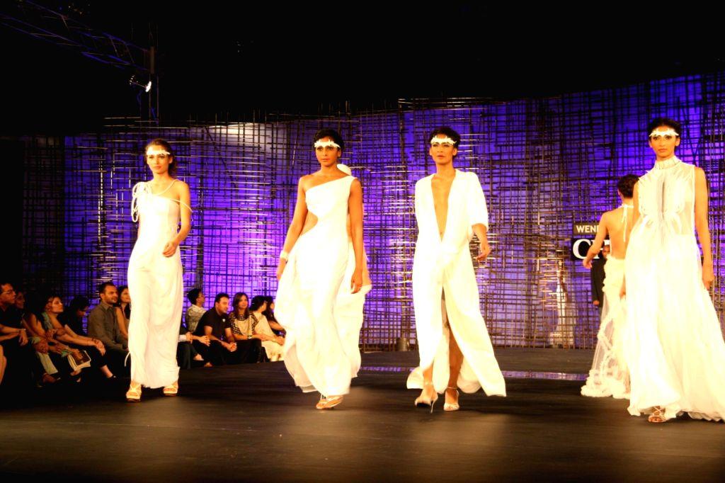 Models walking at designer Wendell Rocdericks Show at Chivas Tour at Grand Hyatt.