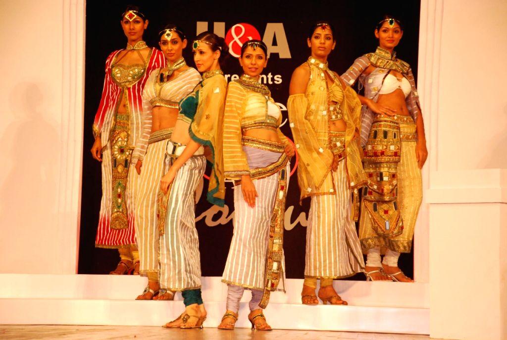 Models walking the ramp at the BD Somani's fashion show in Mumbai.
