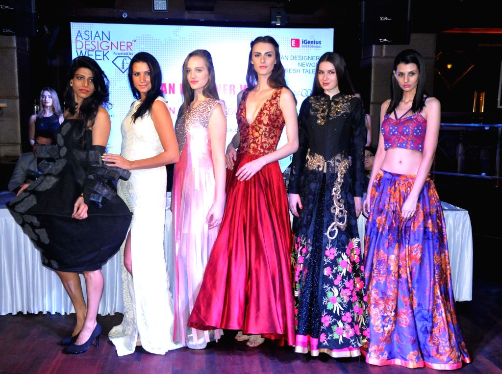 Models walks the ramp at Asian Designer Week 2015 in New Delhi, on Oct 27, 2015.