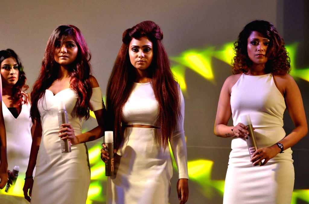 Models walks the ramp during 'Latest Hair Trends' fashion show in Kolkata on Aug 12, 2016.