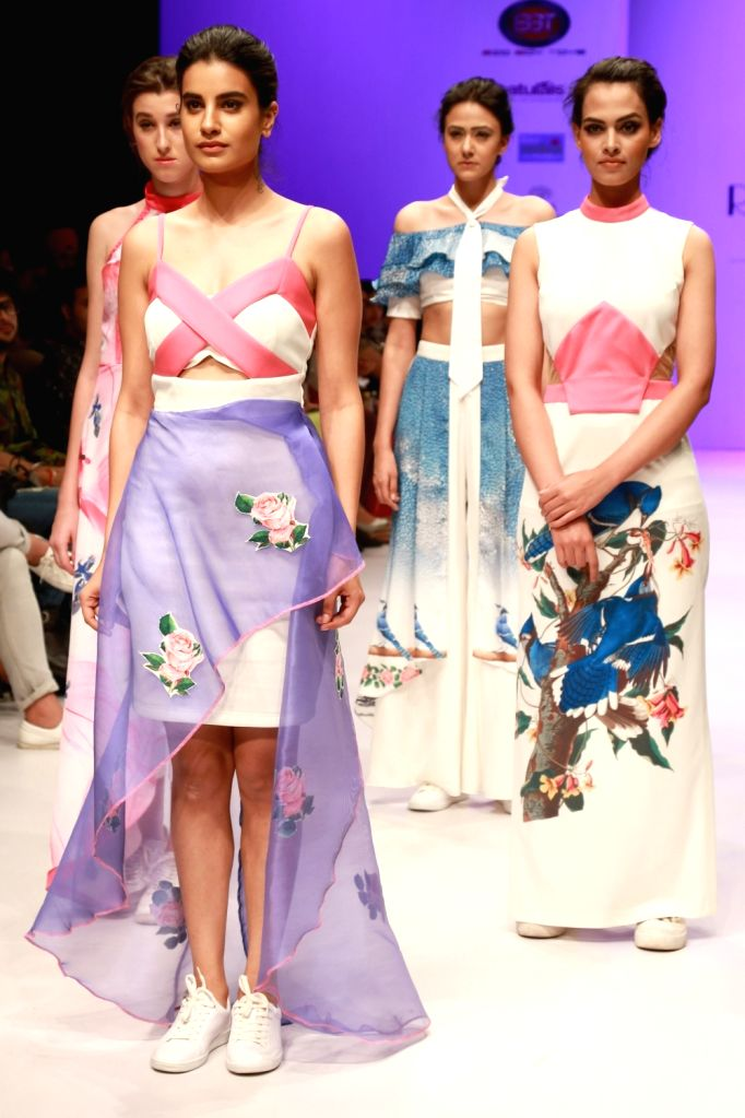 Models walks the ramp for the designers Snidhi and Ishna at the India Runway Week in New Delhi on April 15, 2016.