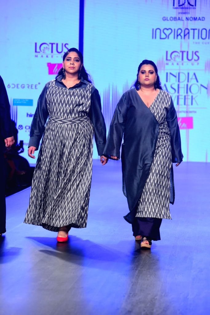 Models walks the ramp showcasing the creation of 'Inspiration Collections' on the second day of Lotus India Fashion Week in New Delhi, on March 14, 2019.