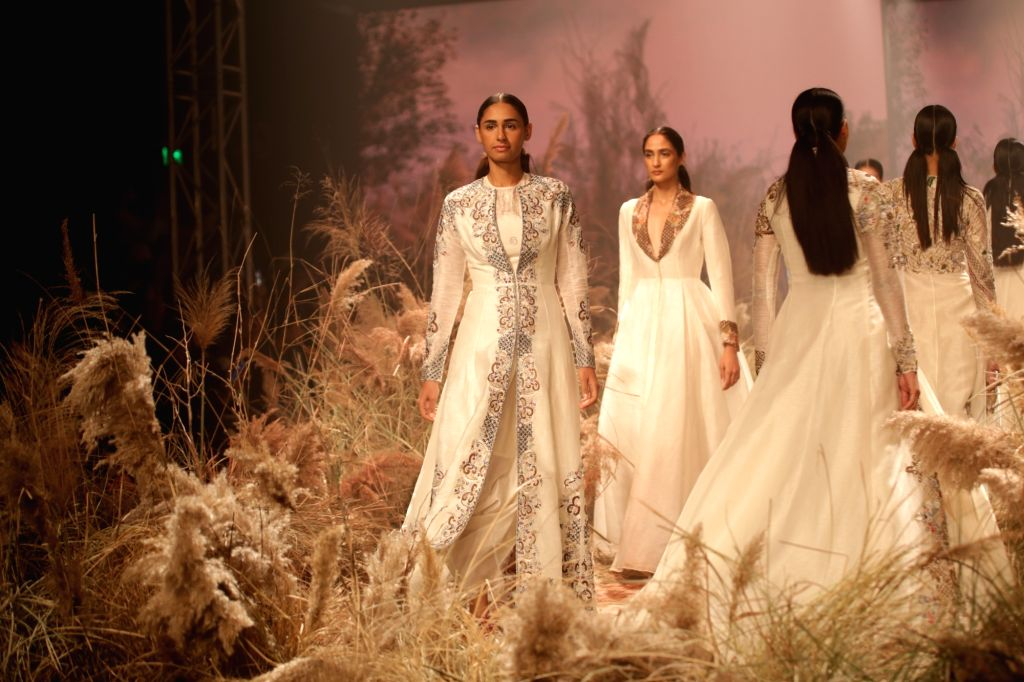 Models walks the ramp showcasing the creations of fashion designer Samant Chauhan on the second day of Lotus India Fashion Week in New Delhi, on March 14, 2019. - Samant Chauhan