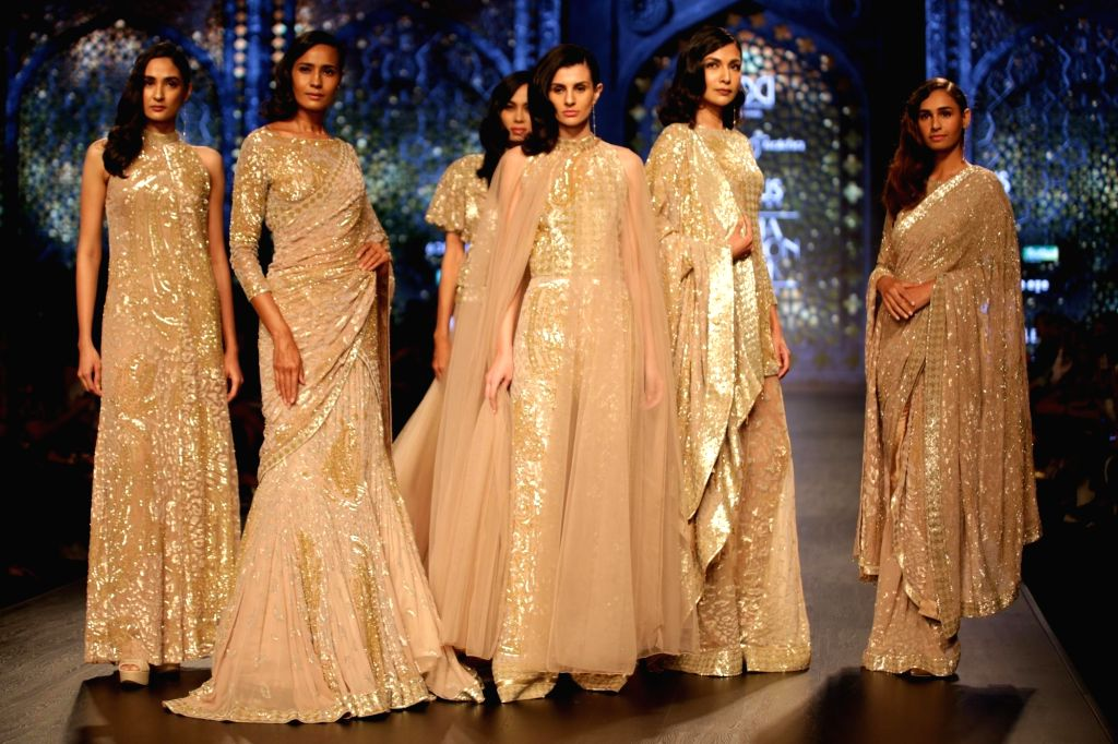 Models walks the ramp showcasing the creations of fashion designer Rabani and Rakha on the third day of Lotus India Fashion Week in New Delhi, on March 15, 2019.