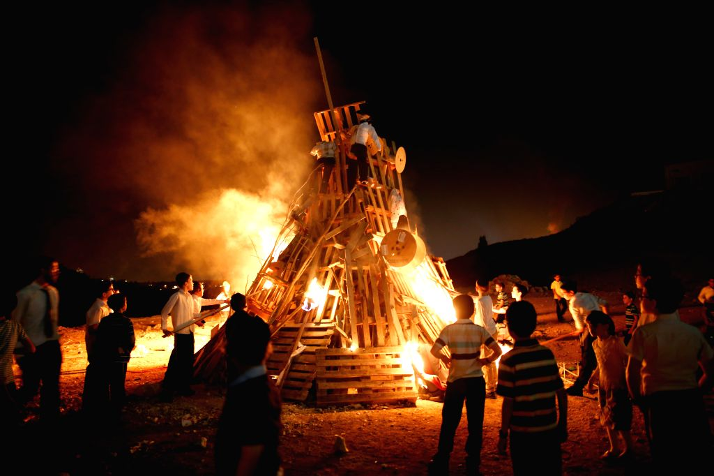 MODI'Ultra-Orthodox Jews light a bonfire during a Lag Baomer celebration in Modi'in Elite on May 13, 2017. Lag Baomer marks the hillula (celebration, interpreted by ...
