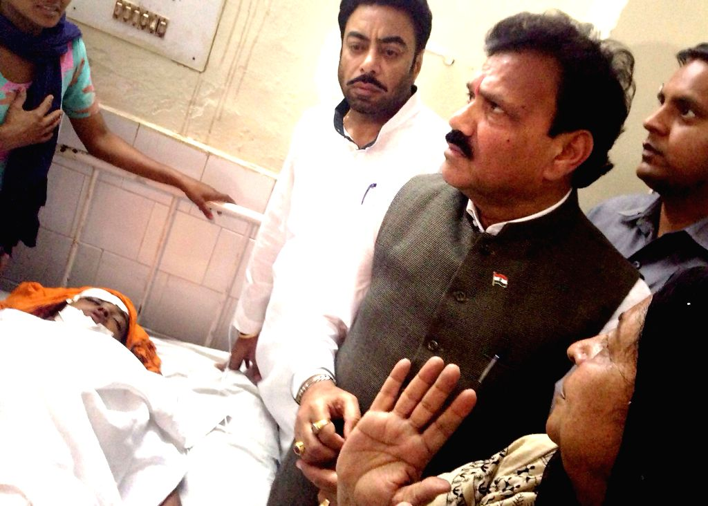 NCSC vice-chairman Raj Kumar Verka visits the mother of a 13-year-old girl who jumped out of a moving bus while trying to escape molestation near Moga town of Punjab, on April 30, 2015. The ... - Kumar Verka